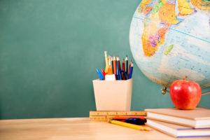 Back to school. School supplies, globe on desk. Education.